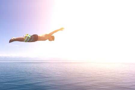Man jump into the ocean Stock Photo