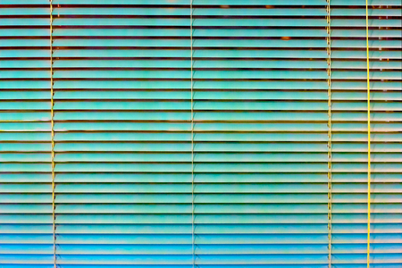 Turquoise bright window blinds. Background texture gradient Фото со стока