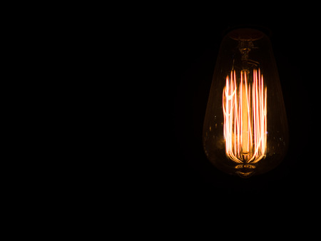 Edison's light bulb in the dark with copy space for text