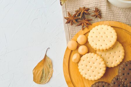 Cookies on the table. Cookies with cinnamon and one leaf. On wooden plate.
