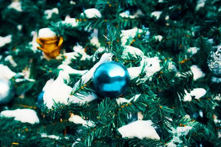 Decorated Christmas tree. Close-up of blue and gold balls hanging from a decorated Christmas tree. 版權商用圖片