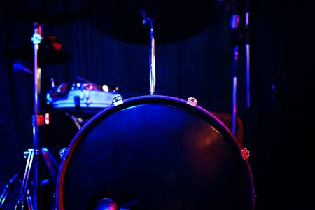 Drums in club. Live concert and stage lights. Stock Photo
