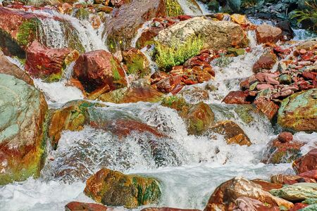 River in the mountains. A small waterfall in the highland in Kyrgyzstan. Happy international mountain day.