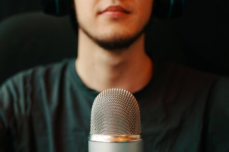 Podcast studio. A person is broadcasting on the air on a microphone.