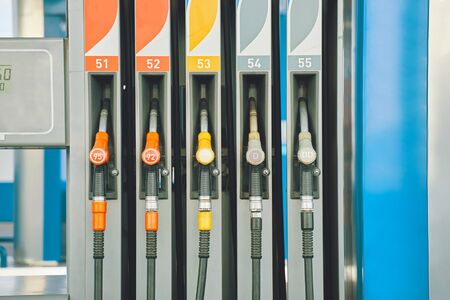 Gas station. Gas pump nozzles on the petrol station. Stock Photo