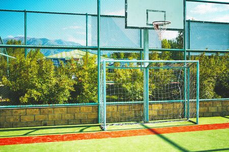 Basketball stadium and Football soccer playground outdoor field. Empty and closed sports area during quarantine