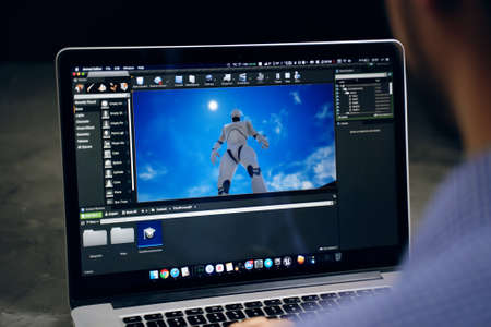 Game developer creating on main screen of unreal engine software on apple macbook macOS operation system. Bishkek, Kyrgyzstan - March 14, 2020.