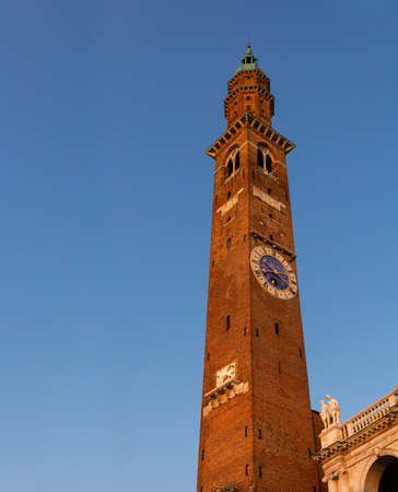 The Torre Bissara, built in medieval times is one of the tallest buildings in the city of Vicenza. It stands next to the famous Palladian Basilica, Andrea Palladio's Renaissance masterpiece. Italy. Archivio Fotografico