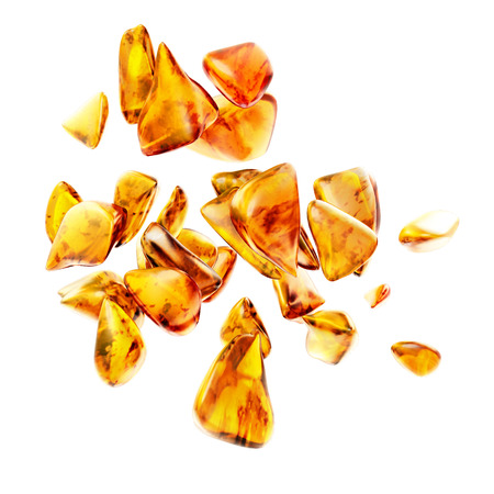 amber light: Beautiful and shimmering baltic amber stone on white background.
