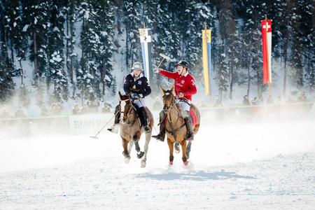 moneyed: St. Moritz - January 31.2015: Unidentified players compete at the 2015 St. Moritz Snow Polo World Cup