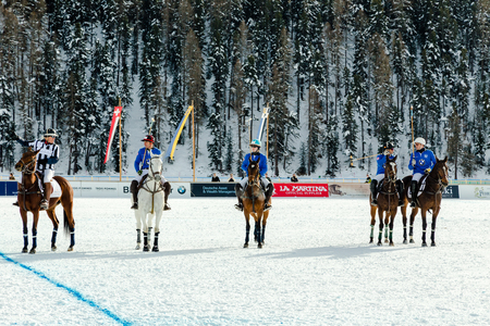doubling: St. Moritz - January 31.2015: Unidentified players compete at the 2015 St. Moritz Snow Polo World Cup