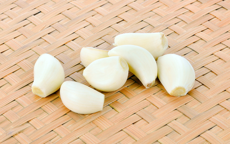 Garlic cloves isolated on bamboo