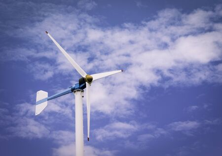 Wind turbines produce electricity or renewable energy. And blue sky
