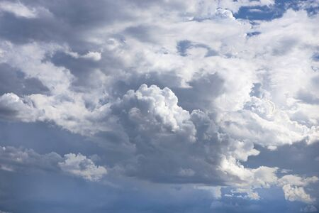 cumulonimbus, thick clouds are gray and cover the sky in a wide area