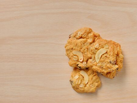 cookie isolated on wood background Stock Photo
