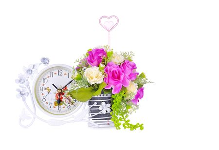 Flower vases and clock tell a significant time on a white background.