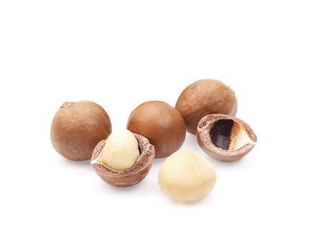 Macadamia nuts, isolated on white background. Shelled and unshelled macadamia.