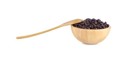 Coffee beans in wooden cup and spoon on white background Stock Photo