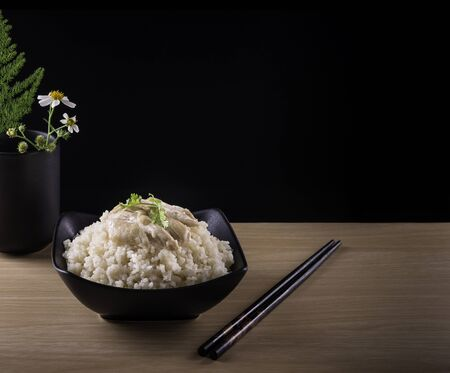 Hainanese chicken rice or rice cooked in chicken broth