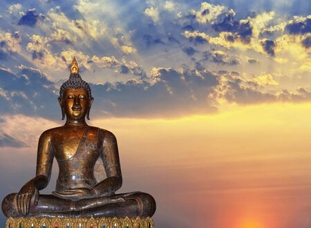 Ancient Buddha statues which represent Buddhism and the sky during sunrise.
