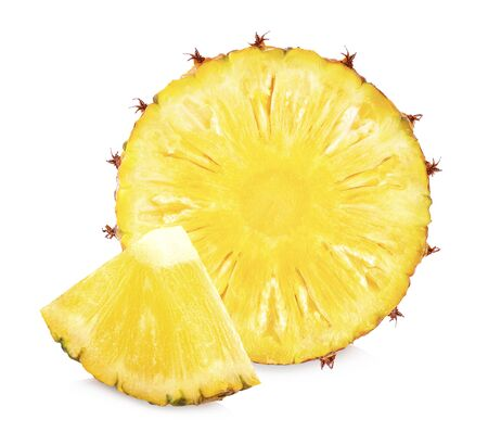 Fresh pineapple slices and pineapples, split in half on a white background