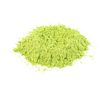 Green matcha powder on white background. Matcha made from finely ground green tea powder. Eat healthy because of high antioxidants.