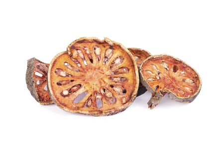 Dry Bael fruit - Slices of dry Bael fruit isolated on white  background
