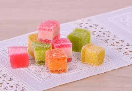 candies. jelly candies on a wood background