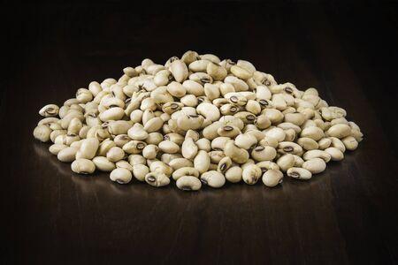 roasted soybeans  in wooden spoon Reklamní fotografie