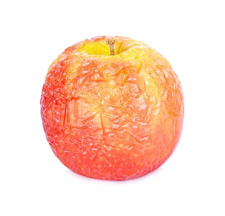 red apple withered on white background