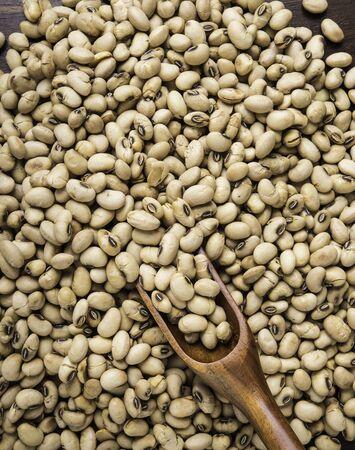 roasted soybeans  in wooden spoon. Top view Reklamní fotografie