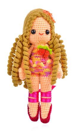 Female doll isolated from white background.
