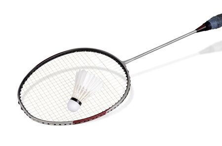 Old badminton racket with a shuttlecock used for badminton competition separately on a white background
