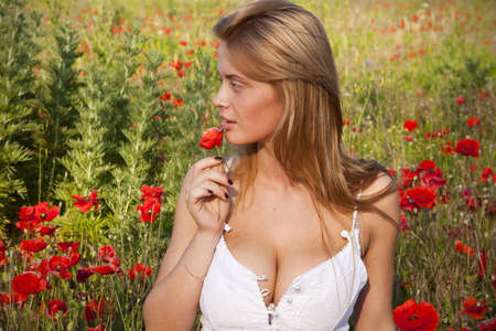 Portrait of a beautiful girl in the poppies