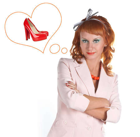Portrait of a red-haired girl in a white suit dreaming of shoes photo
