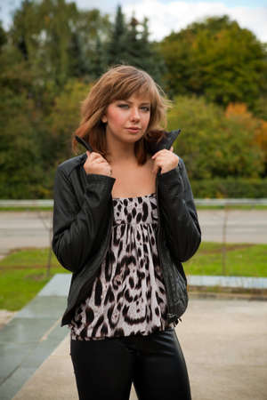 a young brown-haired girl on a city street Stock Photo