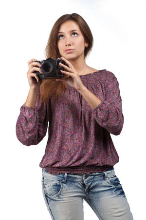 Young brunette girl with a camera photo