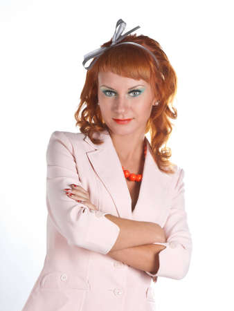 Portrait of a red-haired girl in a white suit Stock Photo