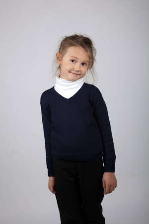 Portrait of a cute girl posing in studio photo