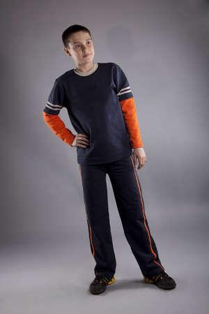 boy in black- orange T-shirt posing in studio photo
