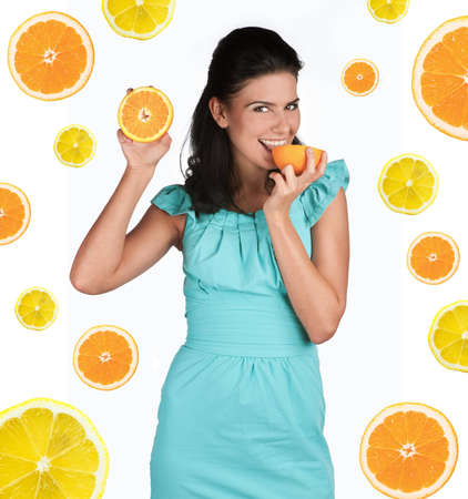 Attractive young girl with fruits