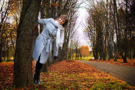 portrait of a beautiful girl on the background of the autumn landscape photo