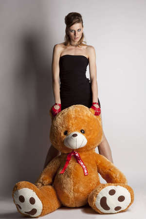 attractive and beautiful casual young woman with teddy bear photo
