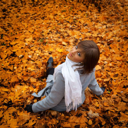 portrait of a beautiful girl on the background of the autumn yellow leaves photo