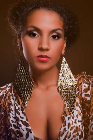portrait of a beautiful dark-skinned elegance woman in the studio