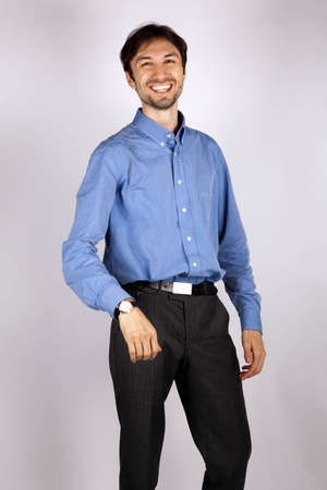 portrait of a smilling man in a blue shirt in studio photo