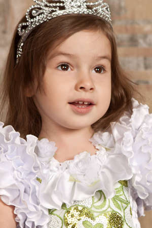 little cute girl in white dress with a tiara on her head Stock Photo - 12104214