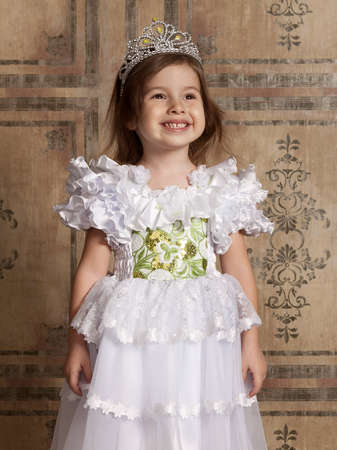 little cute girl in white dress with a tiara on her head Stock Photo - 12104244