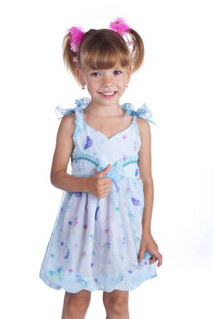 Portrait of a cute little girl in blue dress on the white Stock Photo