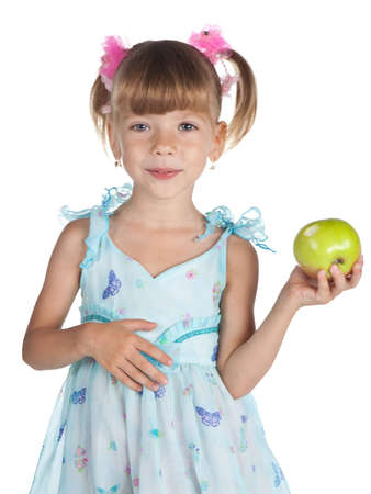 Pretty little girl in a blue dress with an apple in her hand photo